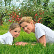 Stock Photo: Young mother and daughter laying