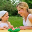 Young mother and daughter - Easter — Stock Photo