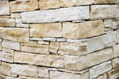 Wall made from sandstone bricks — Stock Photo