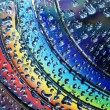 Rainbow colors on discs - Stock Photo