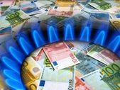 EURO notes and gas stove — Stock Photo