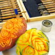 Sweet potato and melon - carving - Stock Photo