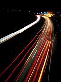 Lights of evening traffic — Stock Photo