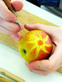 Apple and hands - carving — Stock Photo