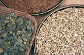 Pompoen, flix en zonnebloem zaden — Stockfoto