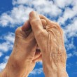 Royalty-Free Stock Photo: Senior woman -  hands over sky