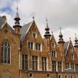 Flemish style house with small towers — Stock Photo #2502038