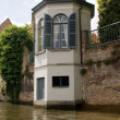 Brugge canal with white tower — Stock Photo #2502146