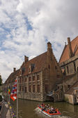 Brugge canal with boat — Stock Photo