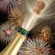 Bottle champagne at new year with fireworks — Stock Photo