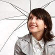 Stock Photo: Smiling girl with an umbrella