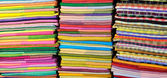 Coloured fabrics at market — Stock Photo