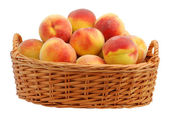 Peach in basket — Stock Photo