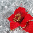 Christmas decorations on tinsel - Stock Photo