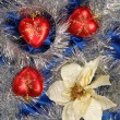 Blue sateen with three hearts decoration — Stock Photo