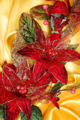 Christmas decoration on golden sateen — Stock Photo