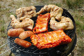 Grilled chicken and sausage — Stock Photo