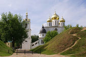 Landscape with white church — Stock Photo