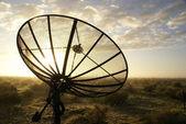 Satellite TV antenna in morning dew — Stock Photo
