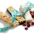 Muesli bars with measuring tape — Stock Photo #2223691