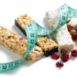 Stock Photo: Muesli bars with measuring tape