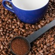 Ground coffee and coffee cup - Stock Photo