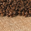 Stock Photo: Coffee beans on jute