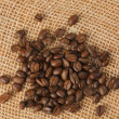 Coffee beans on jute — Stock Photo #2228496