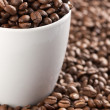 Coffee beans and coffee cup — Stock Photo #2228548