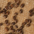 Coffee beans on jute — Stock Photo
