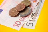 Euros on color background — Stock Photo