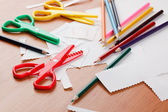 Colourful scissors and crayons — Stock Photo