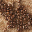 Coffee beans on jute — Stock Photo #2263841