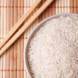 White rice in bowl and chopsticks — Stock Photo