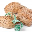 Bread rolls with measuring tape — Stock Photo