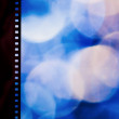 Stock Photo: Film strip on color background