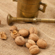 Walnuts laying on jute — Stock Photo