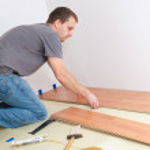 Laying laminate floor — Stock Photo
