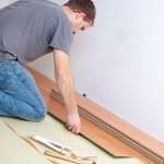 Laying laminate floor — Stock Photo #2277280