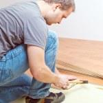 Laying laminate floor — Stock Photo #2277317