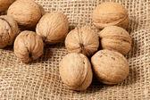Walnuts laying on jute — Stock Photo