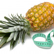 Pineapple with measuring tape — Stock Photo