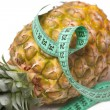 Pineapple with measuring tape — Stock Photo #2280243