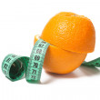 Stock Photo: Orange and measuring tape