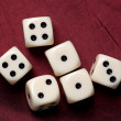 Dice on red fabric — Stock Photo #2281565
