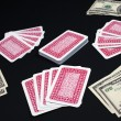 Poker cards and dollars - Stock Photo
