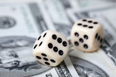 Dice on american money — Stock Photo