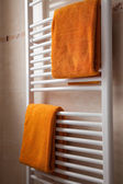 Orange towels on heater — Stock Photo