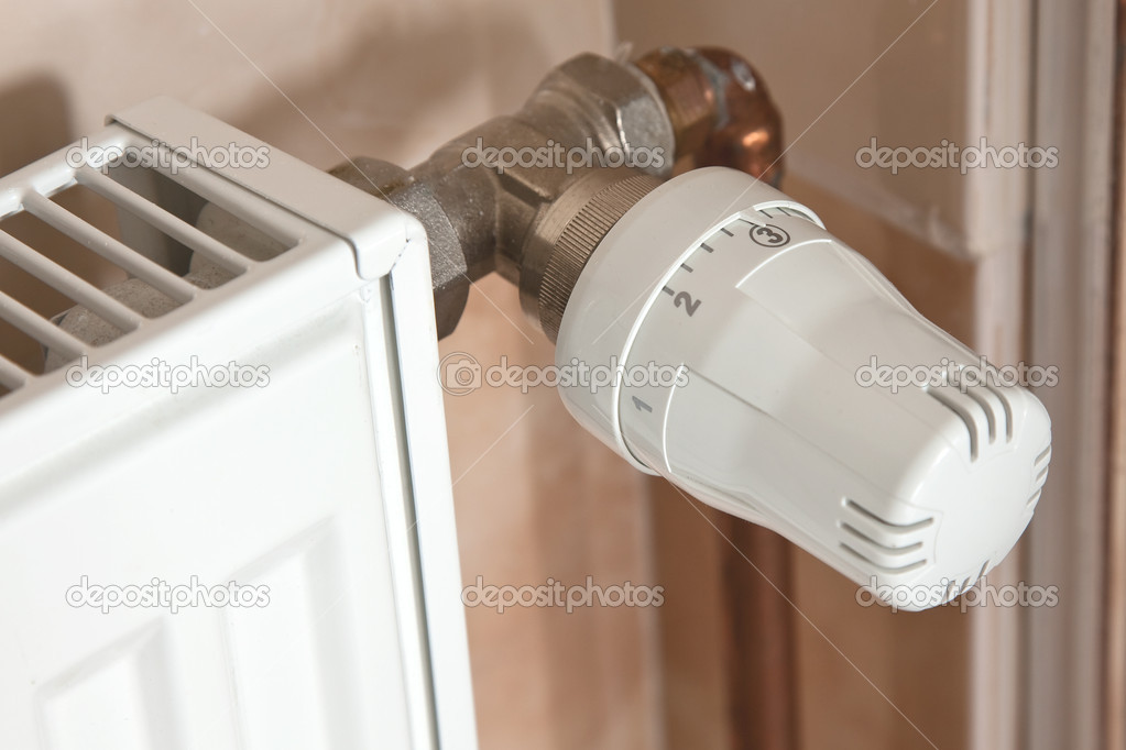 The heating radiator with regulator   Stock Photo #2283608