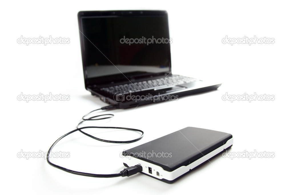 External hard disc connect to laptop on white background — Stock Photo #2434788